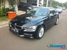 jual bmw 320i hitam 2013 luxury 99,99 km 700 seperti baru